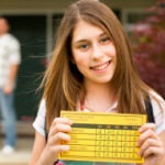 Girl with report card 250px